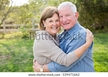 Happy senior mature couple in love outside in nature - stock photo