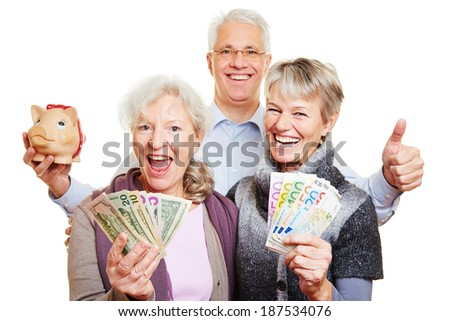 Happy senior people with Euro and dollar bills and piggy bank holding thumbs up - stock photo