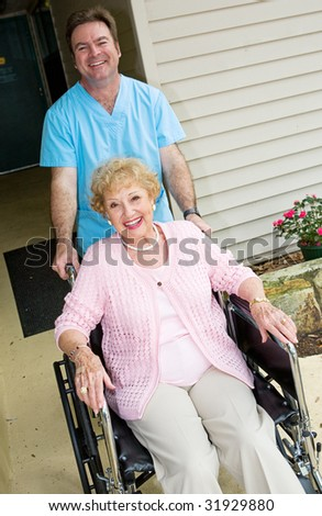 Happy senior woman at a nursing home, cared for by a friendly orderly.