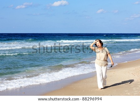 happy senior woman at the beach