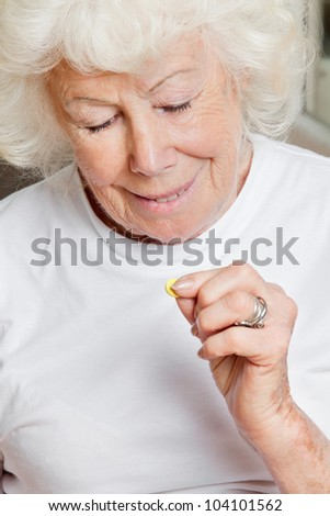 Happy senior woman holding tablet - stock photo