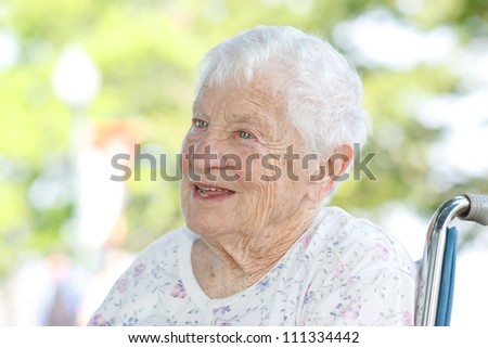 Happy Senior Woman in Wheelchair Outside - stock photo