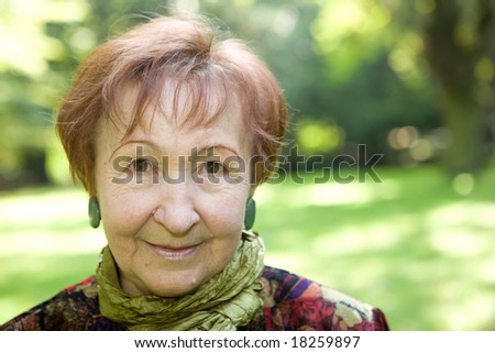 happy senior woman relaxing in park