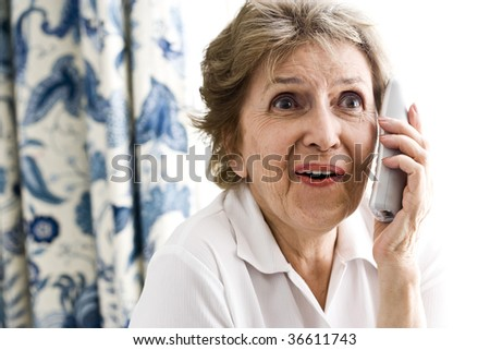 Happy senior woman talking on phone - stock photo