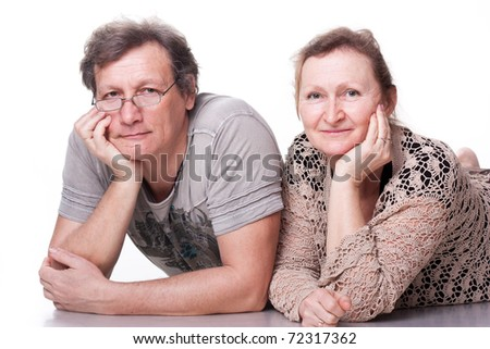 Happy seniors couple in love isolated on white - stock photo