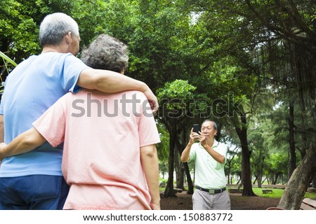 happy seniors taking picture by smart phone in the travel - stock photo