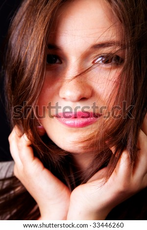 Happy sensual woman with beautiful lips and hair
