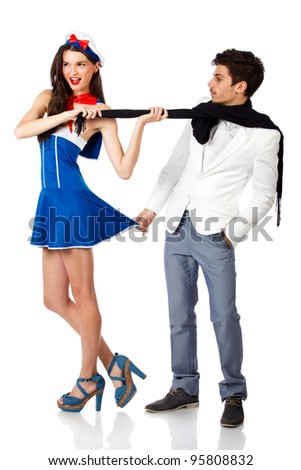 Happy sexy sailor woman flirting with elegant young man. Full body shot. Isolated on white background. High resolution studio image - stock photo