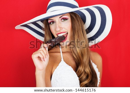 Happy sexy woman holding ice cream - stock photo
