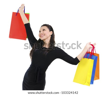 Happy shopper holding shopping bag high isolated on white background - stock photo