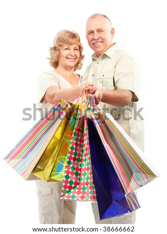 Happy shopping elderly people. Isolated over white background - stock photo
