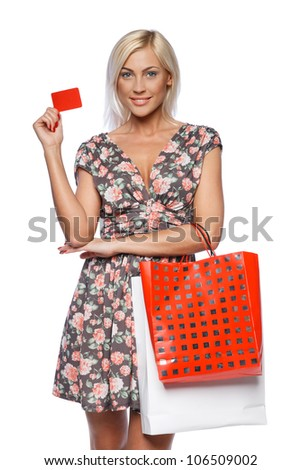 Happy shopping female holding blank credit card, isolated on white background