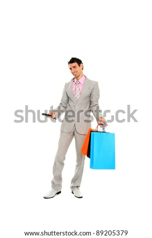 Happy shopping man. Isolated over white background