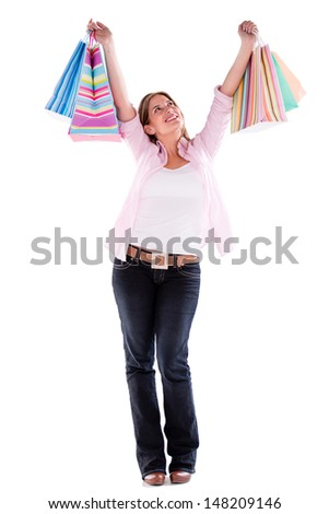 Happy shopping woman with arms up - isolated over white background  - stock photo