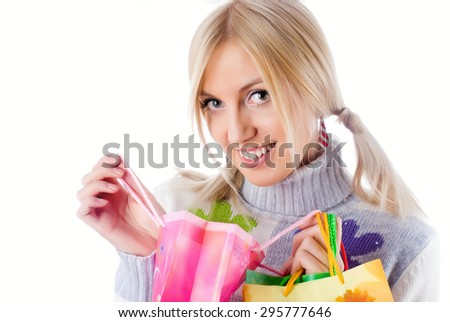 Happy shopping woman with bags over white background - stock photo