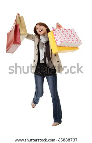 Happy shopping woman with exciting expression holding bags isolated over white.