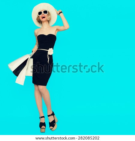 Happy Shopping Woman with shopping bags on blue background - stock photo