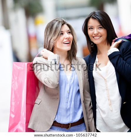 Happy shopping women at the mall and smiling - stock photo