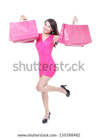 happy shopping young woman running with color bags - isolated on white background, full body, asian model - stock photo
