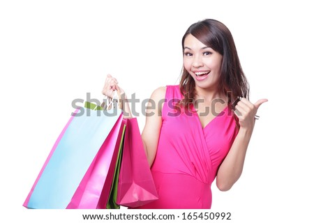 happy shopping young woman show thumb up with bags - isolated on white background, asian model - stock photo