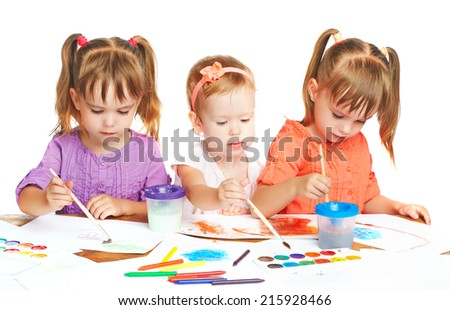happy sister little girl in kindergarten draw paints on a white background - stock photo