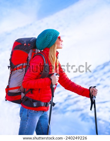 Happy skier girl enjoying view on beautiful mountains covered with snow, active lifestyle, luxury ski resort, winter sport concept - stock photo