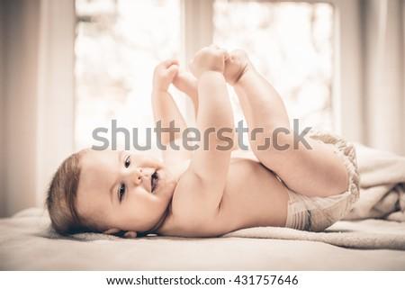 Happy small baby girl - stock photo