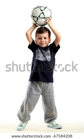 Happy small boy with ball, white background - stock photo