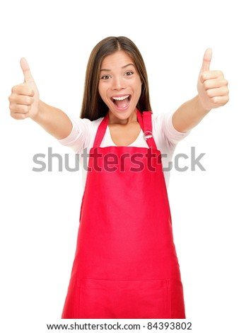 Happy small business owner excited in red apron showing thumbs up success sign isolated on white background. - stock photo