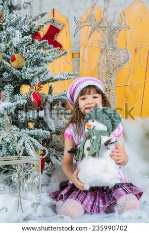 Happy small girl  in front of christmas tree