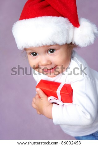 happy small girl in Santa hat have a Christmas - stock photo