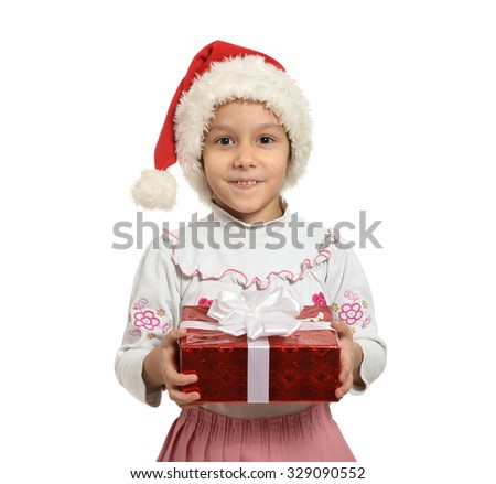 Happy small girl in with present gift on a white background - stock photo