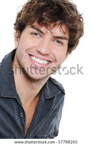 Happy smile and healthy teeth on the face of young man over white - stock photo