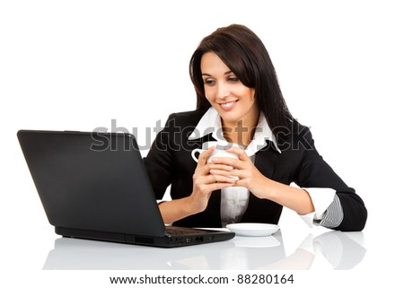 happy smile business woman hold cup of coffee sitting at the desk looking at laptop screen, isolated over white background - stock photo
