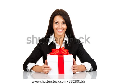 happy smile business woman white gift box with red bow sitting at the desk, isolated over white background - stock photo