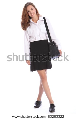 Happy smile from beautiful teenage secondary school student girl wearing black and white school uniform, bag over her shoulder. - stock photo