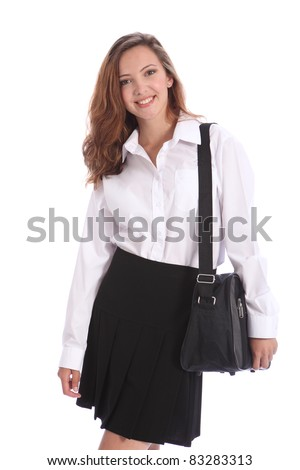Happy smile from beautiful teenage student girl wearing black and white school uniform with school bag over her shoulder. - stock photo