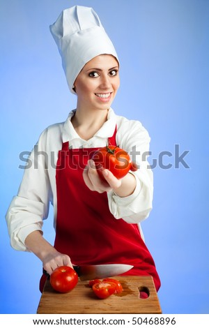 Happy smile  woman chef offer tomatoes on blue background