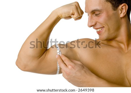 Happy smiled man's mesuring his biceps. Isolated on white in studio. - stock photo