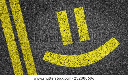 Happy Smiley written on the road - stock photo