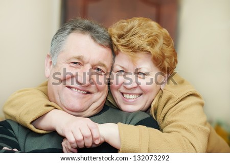 Happy smiling adult couple. Woman embracing a man - stock photo