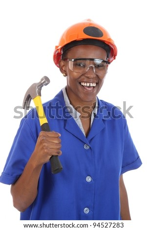 Happy smiling African ethnic lady with hammer and protective safety glasses and hat - stock photo