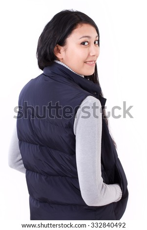 happy, smiling asian-caucasian woman looking back