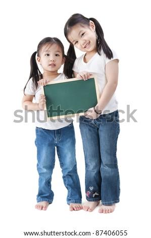 Happy smiling Asian girls holding blank blackboard, on white background. - stock photo