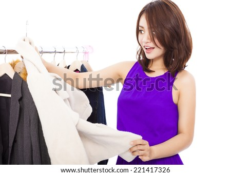 Happy smiling asian Woman shopping clothes over white background - stock photo