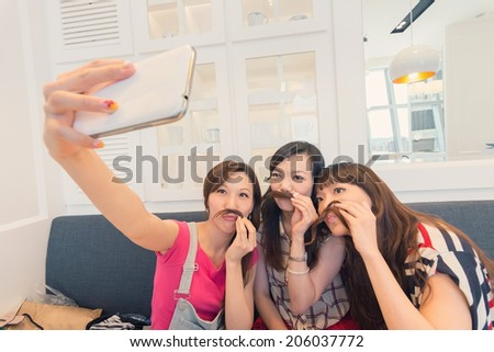 Happy smiling Asian women selfie in a restaurant. - stock photo
