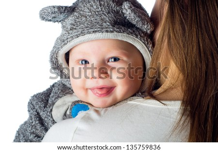 Happy smiling baby on mothers shoulders - stock photo