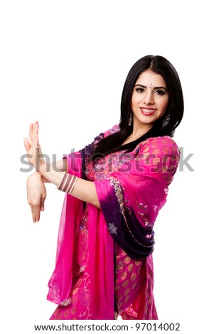 Happy smiling beautiful Bengali Indian Hindu woman in colorful dress in dance pose, isolated - stock photo