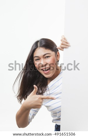 Happy smiling beautiful business woman showing blank signboard