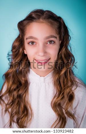 Happy smiling beautiful girl with braces on her teeth studio shot - stock photo